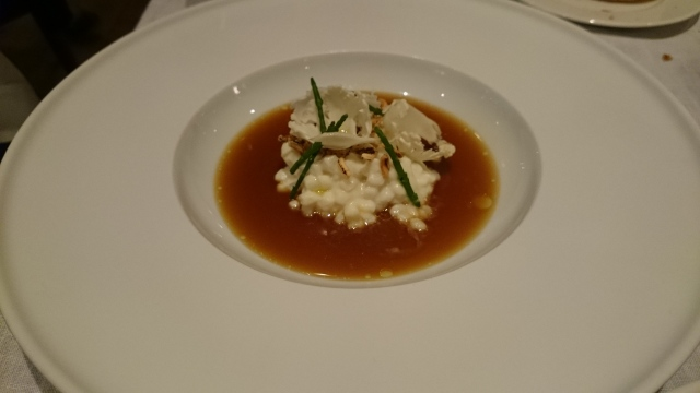 starter: line caught devon squid cooked in cauliflower, roasted squid juices, ink rice & sea herbs