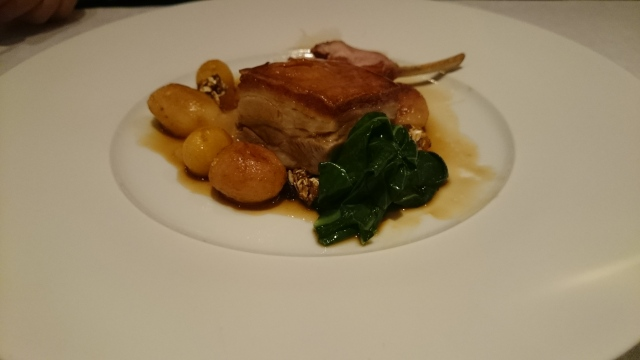 main dish: cumbrian suckling pig, roasted apple, king cabbage, granola clusters