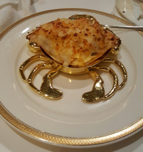 Baked seafood rice with cream sauce in crab shell